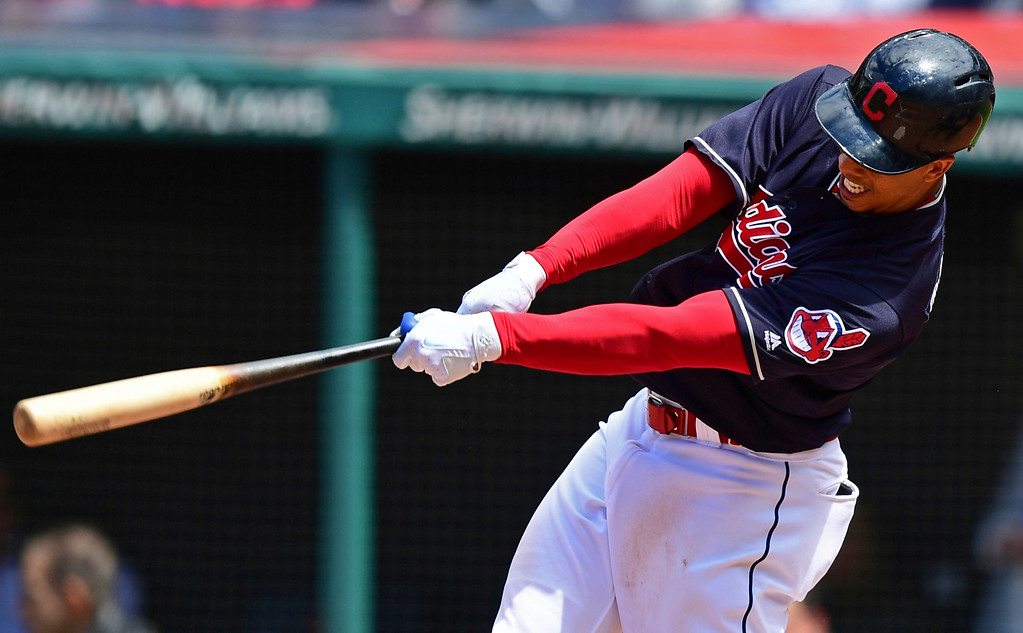 . Cleveland Indians\' Michael Brantley hits a RBI-single off Milwaukee Brewers starting pitcher Chase Anderson in the fifth inning of a baseball game, Wednesday, June 6, 2018, in Cleveland. (AP Photo/David Dermer)