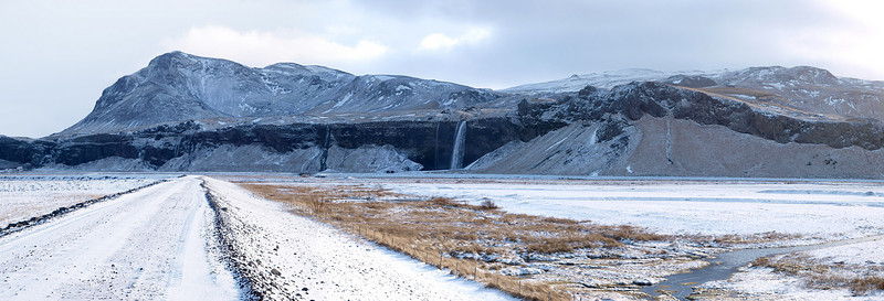 Looking towards Seljalandsfoss from the west. Behind the waterfall is the Yyjafjallajoekull glacier and volcano.