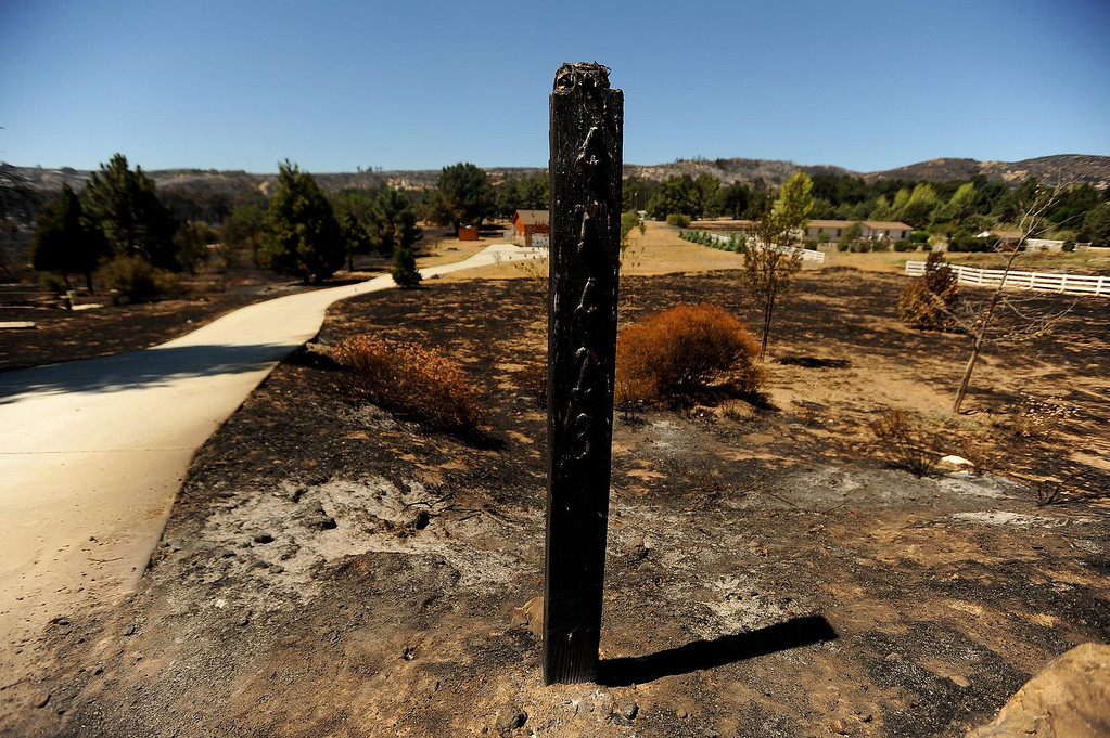 . An address post stands damaged by the Silver Fire stands along Twin Pines Road in the mountains south of Banning August 8, 2013.   GABRIEL LUIS ACOSTA/STAFF PHOTOGRAPHER.