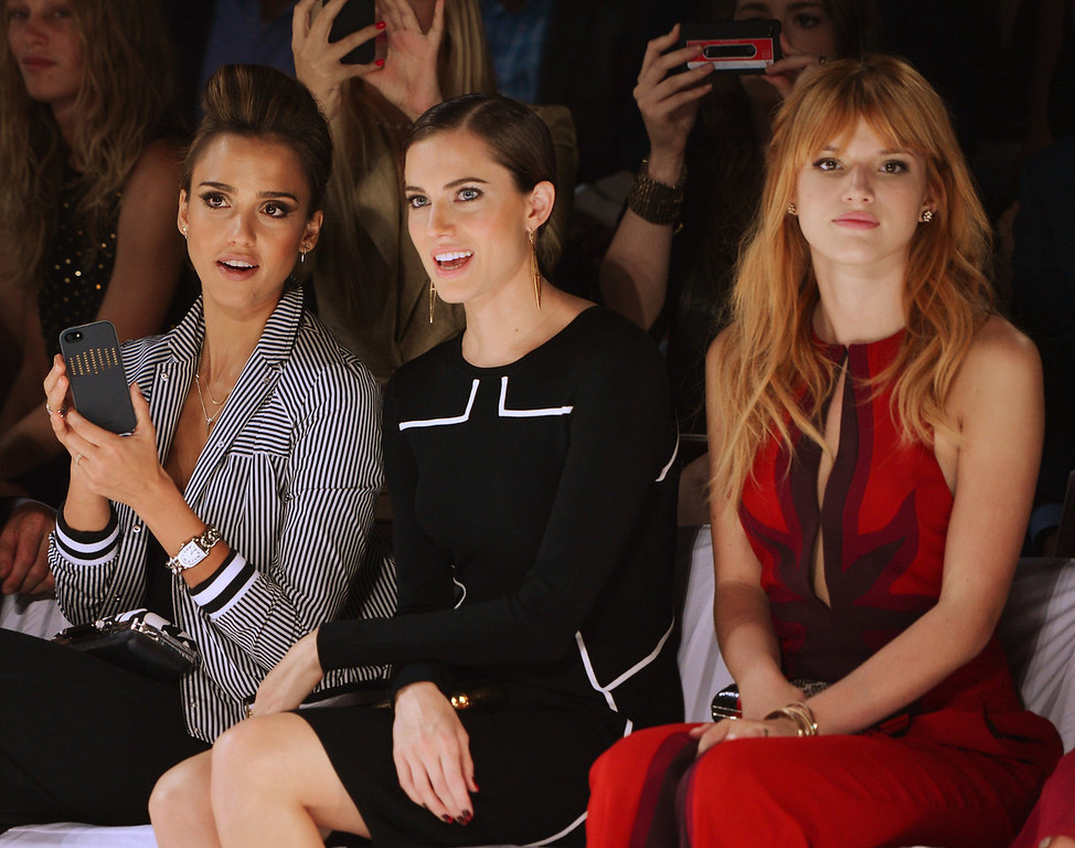 . (L-R) Jessica Alba, Allison Williams and Holland Roden attend the Diane Von Furstenberg fashion show during Mercedes-Benz Fashion Week Spring 2014 at The Theatre at Lincoln Center on September 8, 2013 in New York City.  (Photo by Stephen Lovekin/Getty Images for Mercedes-Benz Fashion Week Spring 2014)