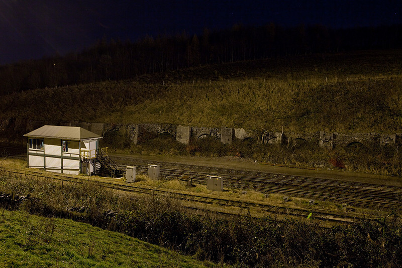 Peak Forest South signal box and industrial ruins at night.