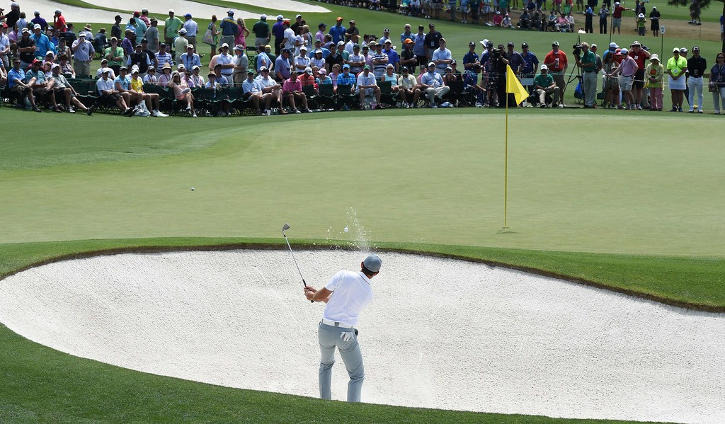 . Carl Schwartzel of South Africa hits out of the sand at the 2nd hole during Round 3 of the 79th Masters Golf Tournament at Augusta National Golf Club on April 11, 2015, in Augusta, Georgia. DON EMMERT/AFP/Getty Images