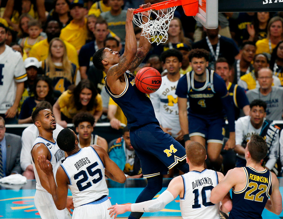 . Michigan\'s Charles Matthews dunks during the second half in the championship game of the Final Four NCAA college basketball tournament against Villanova, Monday, April 2, 2018, in San Antonio. (AP Photo/Brynn Anderson)