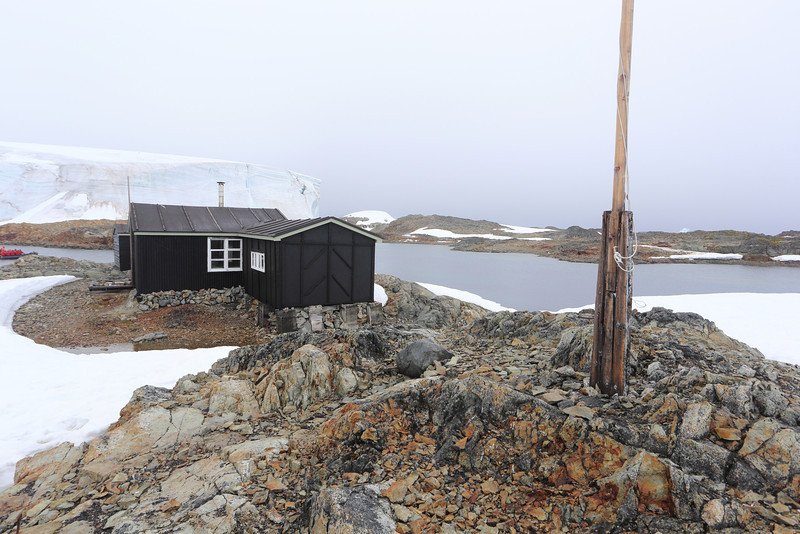 British Wordie House,Winter Island. 65˚15'S, 64˚16'W Located in the Argentine Islands.  Est 1935-Closed in 1954.. A huge snow bank and channel we came through, in the background. 