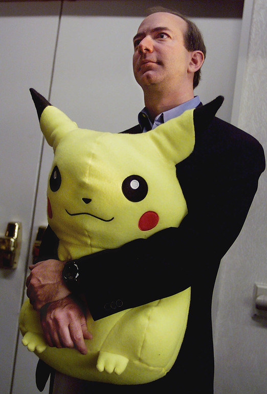 . 1999: Jeff Bezos. Jeff Bezos, founder and CEO of Amazon.com, holds a large, stuffed Pikachu Pokemon doll as he listens to comments at a New York news conference, Tuesday Nov. 9, 1999. (AP Photo/Richard Drew)