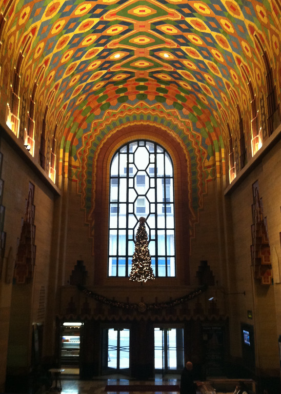 . This Dec. 3, 2014 photo shows a detail from the interior of The Guardian building in downtown Detroit, an Art Deco skyscraper that is a National Historic Landmark. The building was constructed in the late 1920s. The sea of colorful, intricate mosaics, geometric patterns, soaring ceiling and tall arched window gives the lobby the feeling of a cathedral. (AP Photo/Beth J. Harpaz)