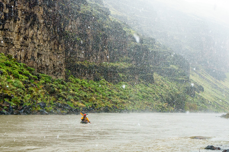 Christian Woodard paddling through the desert canyons of the Middle Owyhee during a surprise May snowstorm.