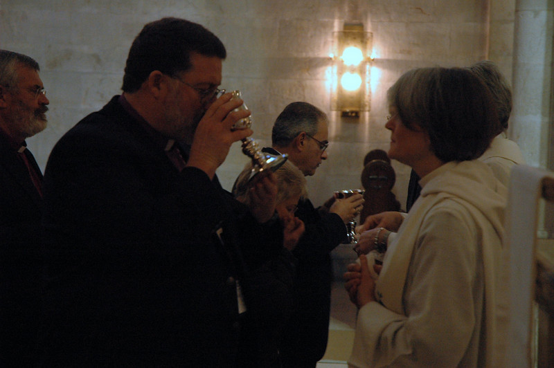 Bishop Michael Keys, ELCA Alaska Synod, takes communion Jan. 7 at a Conference of Bishops' worship service at the Lutheran Chuch of the Redeemer, Jerusalem.  The Rev. Susan Briehl, serves the wine.