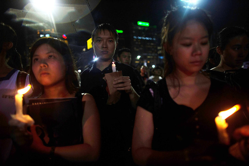. People take part in a candlelight vigil on the 24th anniversary of the Tiananmen Square protests during heavy rain on June 4, 2013 in Hong Kong, Hong Kong.  Held to mark the crackdown on the pro-democracy movement in Beijing\'s Tiananmen Square on June 4, 1989.Pro-democracy groups hope to draw 150,000 people to the annual candlelight vigil in Hong Kong\'s Victoria Park, the only commemoration on Chinese soil. (Photo by Lam Yik Fei/Getty Images)