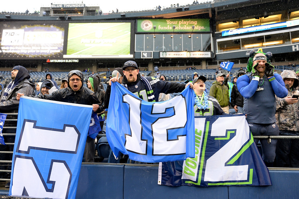 . SEATTLE, WA - JANUARY 11:  Seattle Sehawks fans hold up the 12th Man signs before the Seahawks take on the New Orleans Saints in the NFC Divisional Playoff Game at CenturyLink Field on January 11, 2014 in Seattle, Washington.  (Photo by Harry How/Getty Images)