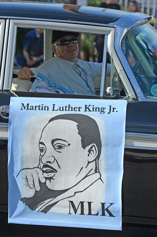 . The 26th Annual Martin Luther King, Jr., Peace & Unity Parade Saturday, January 18, 2014, Long Beach, CA. Classic cars sport images of the reverend. Photo by Steve McCrank/Daily Breeze