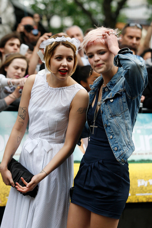 . In this Wednesday, June 17, 2009, file photo, Peaches Geldof, left, talks to her sister Pixie Geldof, daughters of Bob Geldof, as they arrive for the British premiere of the film \'Bruno\' in London. (AP Photo/Sang Tan, File)
