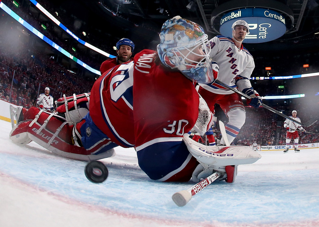 . MONTREAL, QC - MAY 17:  Goaltender Peter Budaj #30 of the Montreal Canadiens is unable to stop a goal by Derek Stepan #21 of the New York Rangers in the third period in Game One of the Eastern Conference Finals of the 2014 NHL Stanley Cup Playoffs at the Bell Centre on May 17, 2014 in Montreal, Canada.  (Photo by Bruce Bennett/Getty Images)