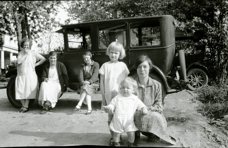 Is that Signe standing against the car?  In forefront, Lalla, Thor and Dorothea.