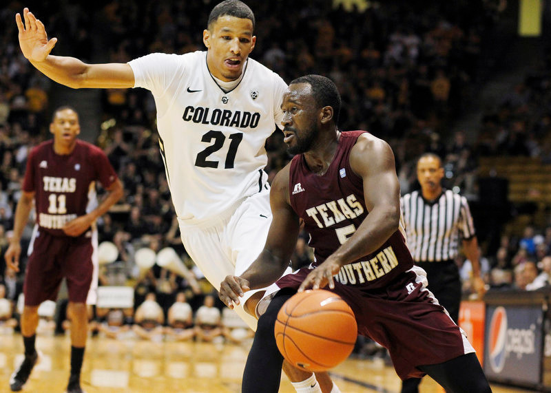 . Texas Southern guard Omar Strong, front, struggles to move the ball as Colorado guard Andre Roberson covers in the first half of an NCAA college basketball game in Boulder, Colo., on Tuesday, Nov. 27, 2012. (AP Photo/David Zalubowski)