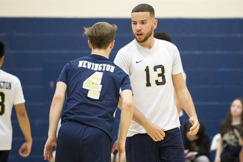 05/13/19  Wesley Bunnell   Staff  Newington boys volleyball vs Westfield MA on Monday night at Newington High School. Collin Liedke (4) and Leonel Caceres (13).