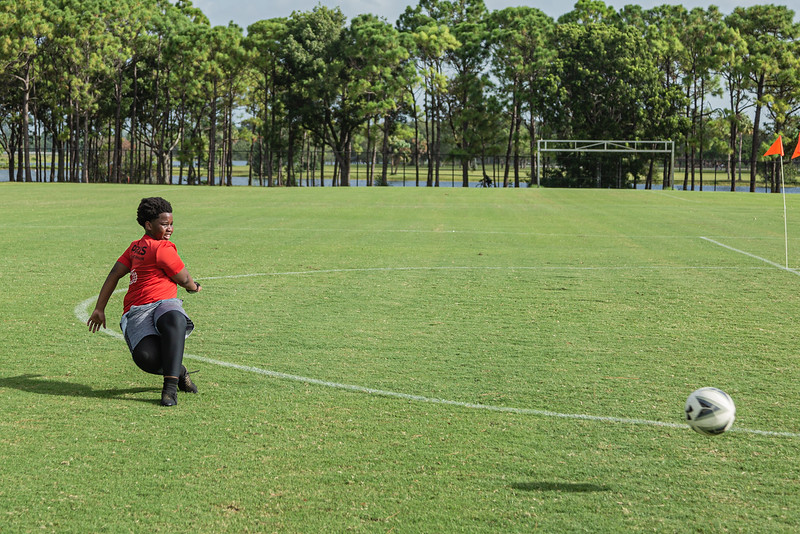 Rodendy Joachim, 11, of Royal Palm Beach fires a shot on goal as he practices his skills at Okeeheelee Park, Tuesday, August 25, 2020. [JOSEPH FORZANO/palmbeachpost.com]