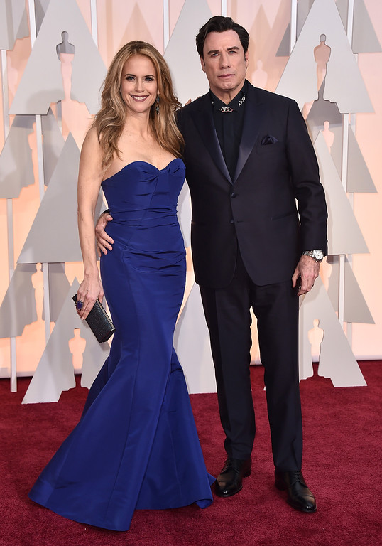 . Kelly Preston, left, and John Travolta arrive at the Oscars on Sunday, Feb. 22, 2015, at the Dolby Theatre in Los Angeles. (Photo by Jordan Strauss/Invision/AP)