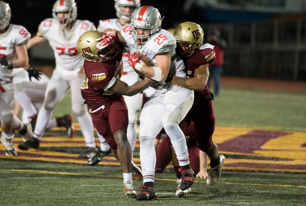 11/01/19 Wesley Bunnell | StaffrrNew Britain football was defeated 17-14 by Conard in OT in a game played on Friday night at Veterans Stadium. The Conard ball carrier is tackled for a loss.