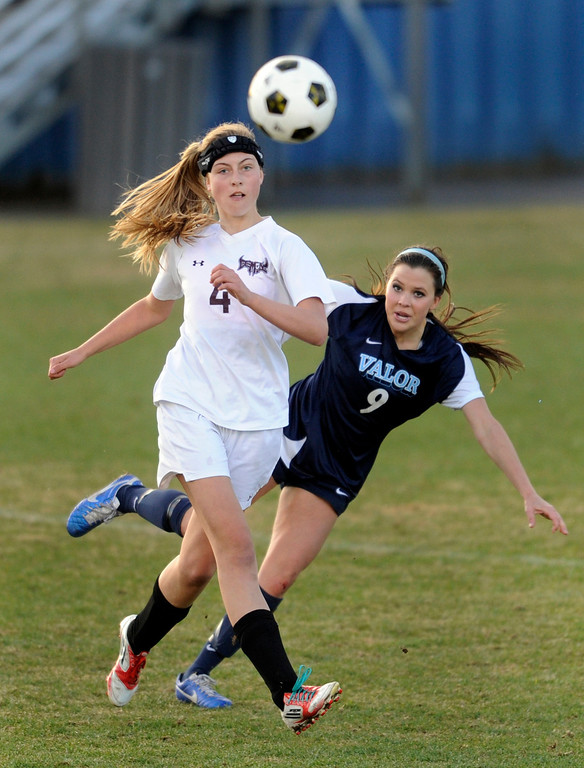 . PARKER, CO. - APRIL 2: Valor senior forward Hannah Hommel (9) released a shot past Golden defender Riley Sanders (4) in the second half. The Valor Christian High School girl\'s soccer team defeated Golden 4-1 Wednesday night, April 3, 2013.  Photo By Karl Gehring/The Denver Post)