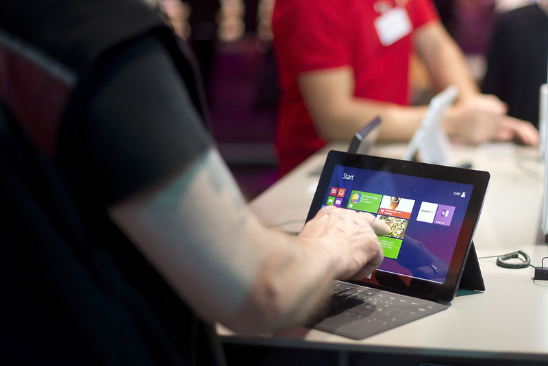 . A Visitor touches a surface tablet at the Microsoft stand at the 2014 CeBIT technology Trade fair on March 10, 2014 in Hanover, Germany. CeBIT is the world\'s largest technology fair and this year\'s partner nation is Great Britain.  (Photo by Nigel Treblin/Getty Images)