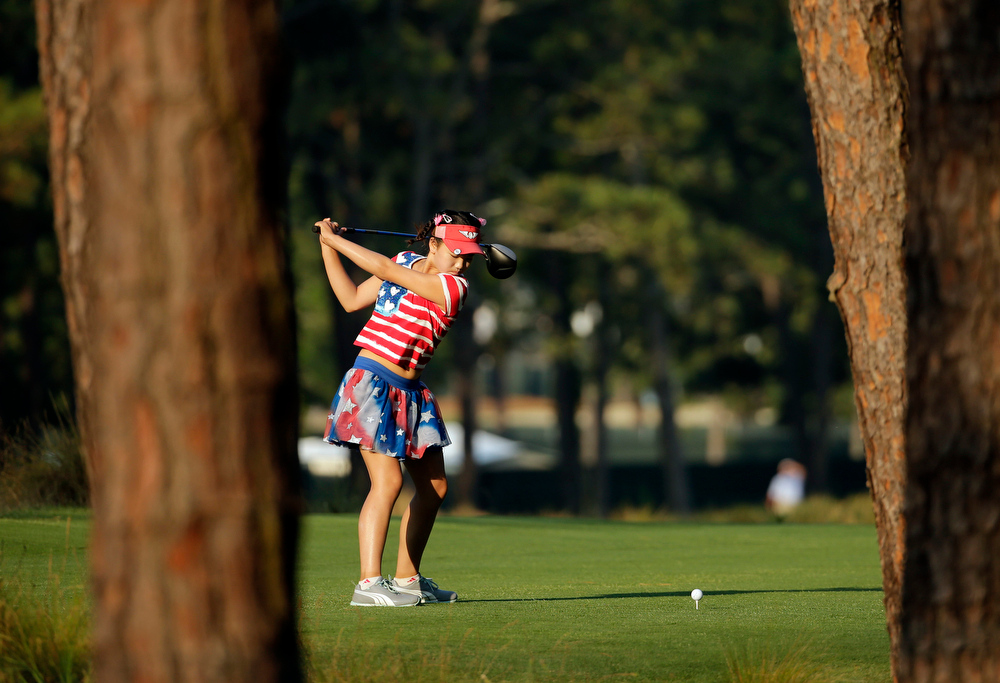 . Lucy Li prepares to hit her tee shot on the 11th hole during the first round of the U.S. Women\'s Open golf tournament in Pinehurst, N.C., Thursday, June 19, 2014. (AP Photo/Chuck Burton)