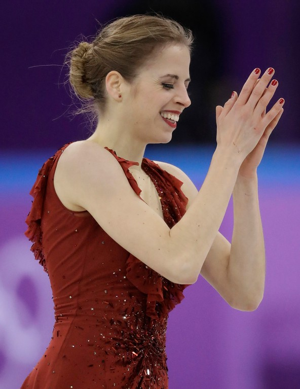 . Carolina Kostner, of Italy receives applause after her performance in the ladies single figure skating short program in the Gangneung Ice Arena at the 2018 Winter Olympics in Gangneung, South Korea, Sunday, Feb. 11, 2018. (AP Photo/Bernat Armangue)