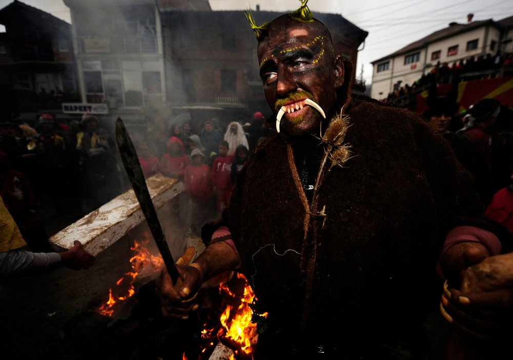 . Revelers parade the streets during a carnival in the village of Vevcani, some 170 km (106 miles) from the Macedonian capital Skopje, January 14, 2013. Vevcani village marks the Orthodox St. Vasilij Day annually with a carnival that features a 1,400-year-old celebration with pagan roots. The highlights of the carnival include a political satire where masked villagers act out current events.  REUTERS/Ognen Teofilovski