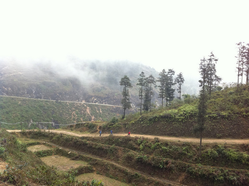 Trekking down into the valley below Sapa. That's the girls across the way, with our guide.