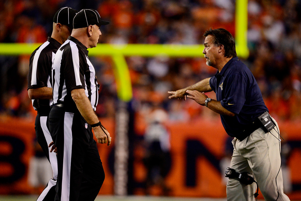 . DENVER, CO - AUGUST 24: head coach Jeff Fisher of the St. Louis Rams speaks with the referees during the second half of action of an NFL preseason game at Sports Authority Field at Mile High on August 24, 2013. This is the third game of the preseason for the Broncos. (Photo by AAron Ontiveroz/The Denver Post)