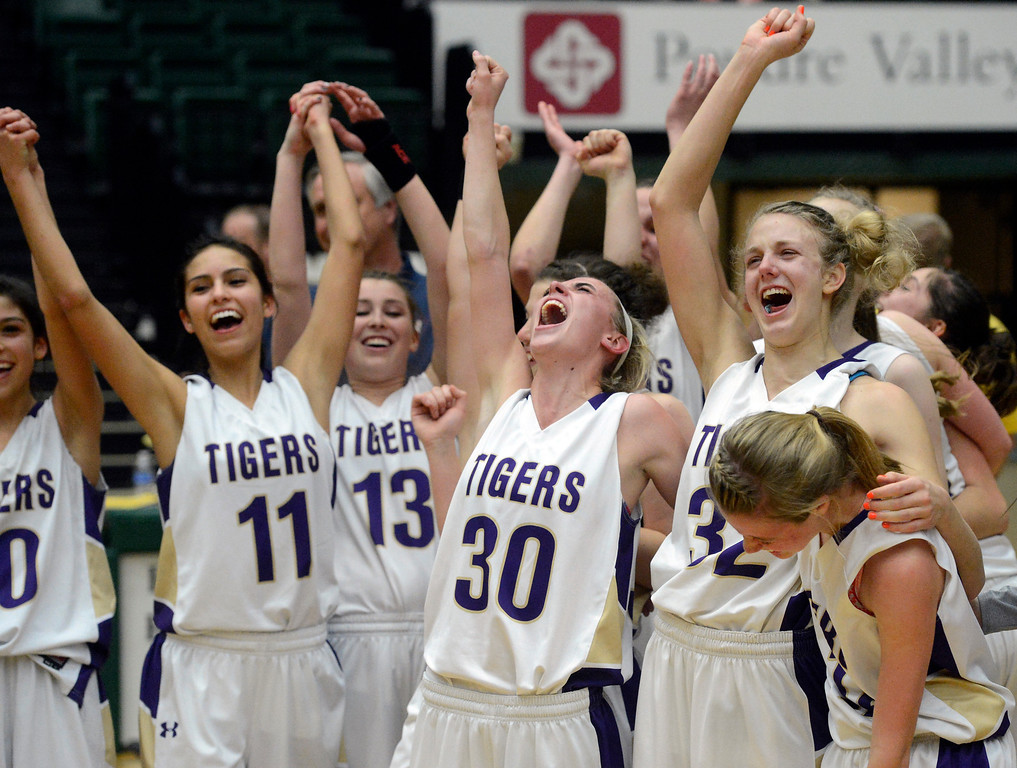 . FT. COLLINS, CO. - MARCH 16TH: The Holy Family Tigers celebrate their double overtime victory over the St. Mary\'s Pirates for the 3A Colorado State Championship game at Moby Arena Saturday evening, March 16th, 2013. (Photo By Andy Cross/The Denver Post)