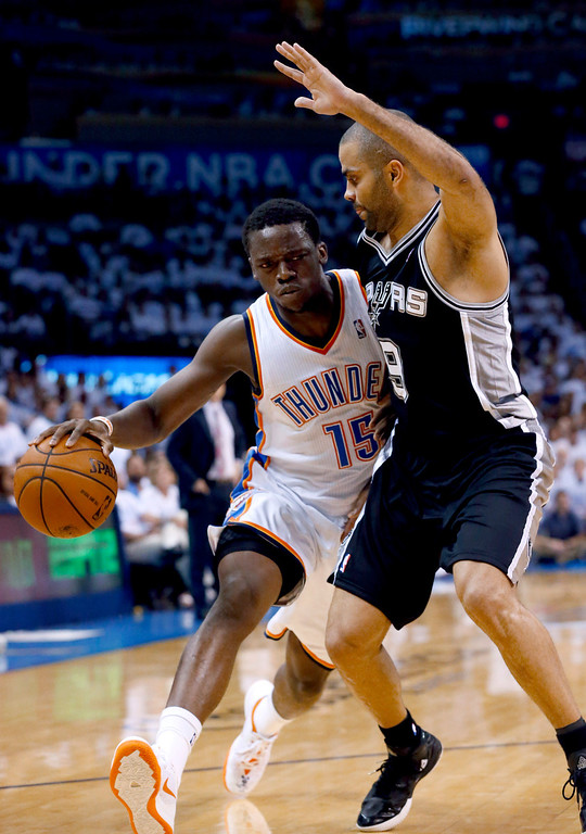 . Oklahoma City Thunder guard Reggie Jackson (15) drives against San Antonio Spurs guard Tony Parker (9) during the first half of Game 6 of the Western Conference finals NBA basketball playoff series in Oklahoma City, Saturday, May 31, 2014. (AP Photo/Sue Ogrocki)