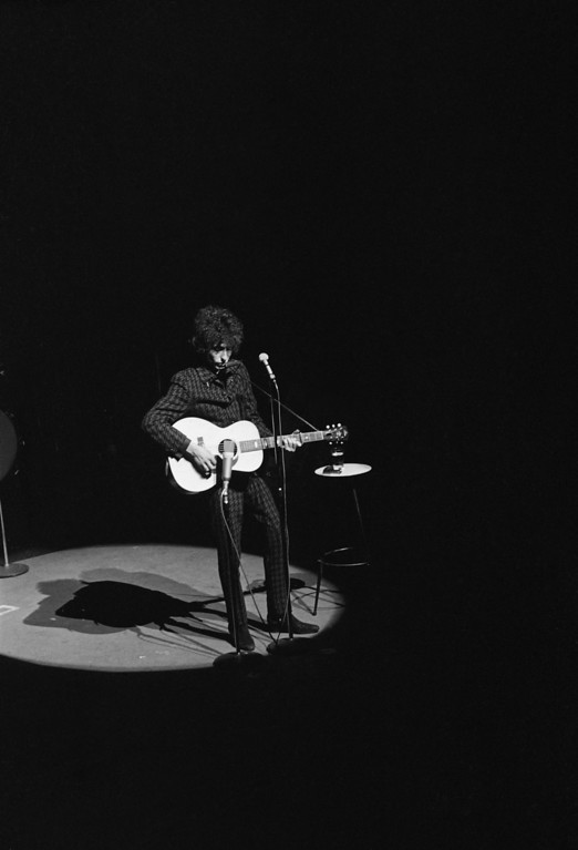 . American singer Bob Dylan performs on stage at the Olympia Theater in Paris, France, May 24, 1966, on his 25th birthday.  (AP Photo)