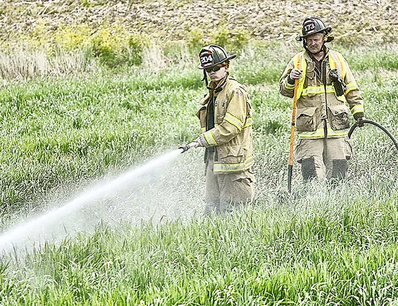 Jack Haley/Messenger Post MediaFirefighters from Victor, Fishers, Farmington and Egypt were on the scene of a field fire which ran between Blazey and Bortle Roads in the town of Victor Wednesday morning.
