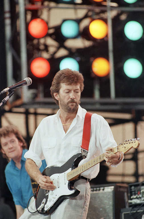 . FILE - In this July 13, 1985 file photo, Eric Clapton performs at the Live Aid concert in Philadelphia. The Fender Stratocaster, used by countless professional and amateur musicians, celebrates its 60th anniversary in 2014. (AP Photo/George Widman)