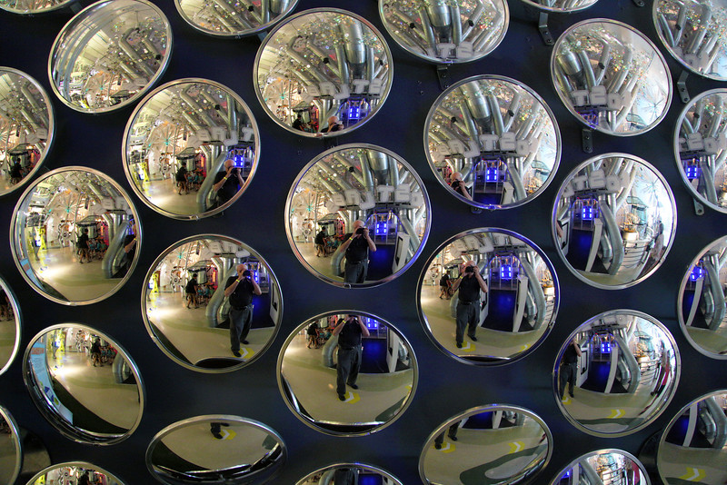 "In the Discovery Museum: We're children again.  I see myself in spherical mirrors of a ""compound eye""."