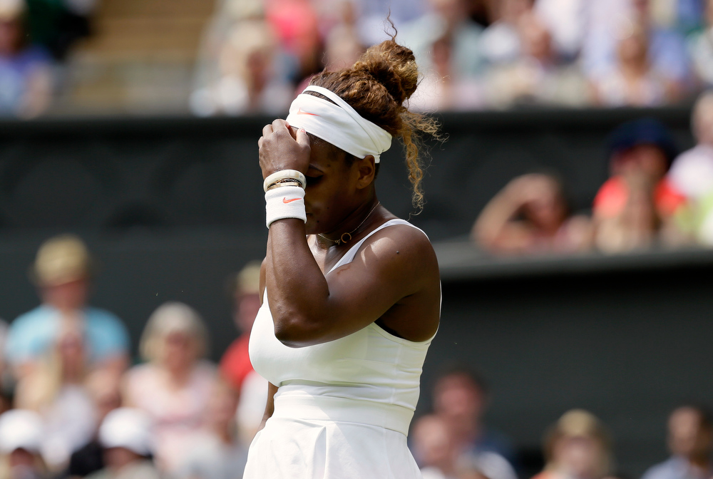 . Serena Williams of the United States reacts during her Women\'s singles match against Sabine Lisicki of Germany at the All England Lawn Tennis Championships in Wimbledon, London, Monday, July 1, 2013.  (AP Photo/Alastair Grant)