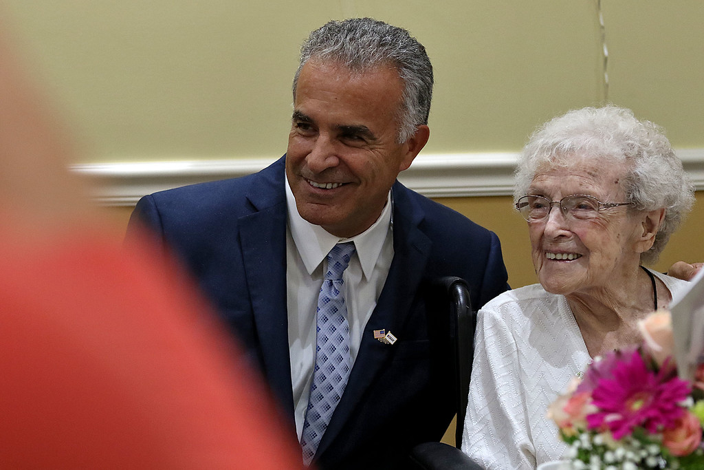 . Norma Schofield had her 106 birthday on Tuesday, September 12, 2018 at Manor On the Hill in Leominster where she now lives. Mayor Dean Mazzarella poses for pictures with Norma during his visit to give her a certificate from the city. SENTINEL & ENTERPRISE/JOHN LOVE