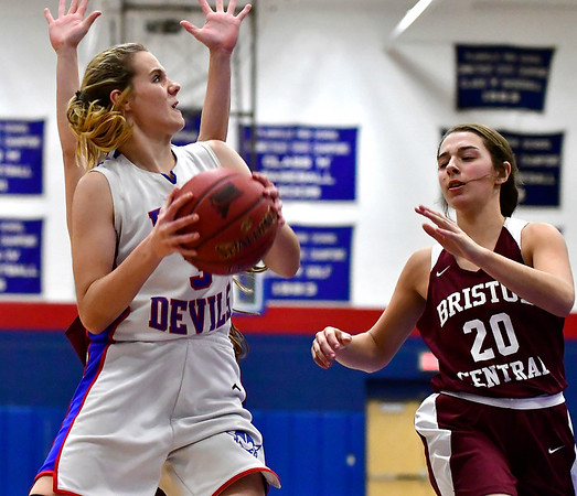 12/13/2018 Mike Orazzi | Staff Plainville High School's Caitlyn Barker (3) and Bristol Central's Kayla Beaulieu (22) and Gwen Torreso (20) during Thursday night's basketball game with Bristol Central at PHS.