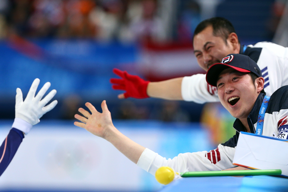 . Members of South Korean short track team celebrate winning the gold medal in the Short Track Ladies\' 3000m Relay Final at Iceberg Skating Palace on day 11 of the 2014 Sochi Winter Olympics on February 18, 2014 in Sochi, Russia.  (Photo by Paul Gilham/Getty Images)