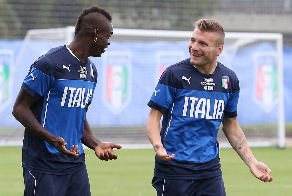 . Italy\'s Mario Balotelli, left, talks with his teammate forward Ciro Immobile during a training session, in Mangaratiba, Brazil, Tuesday, June 10, 2014. Italy will play in group D of the Brazil 2014 soccer World Cup. (AP Photo/Antonio Calanni)