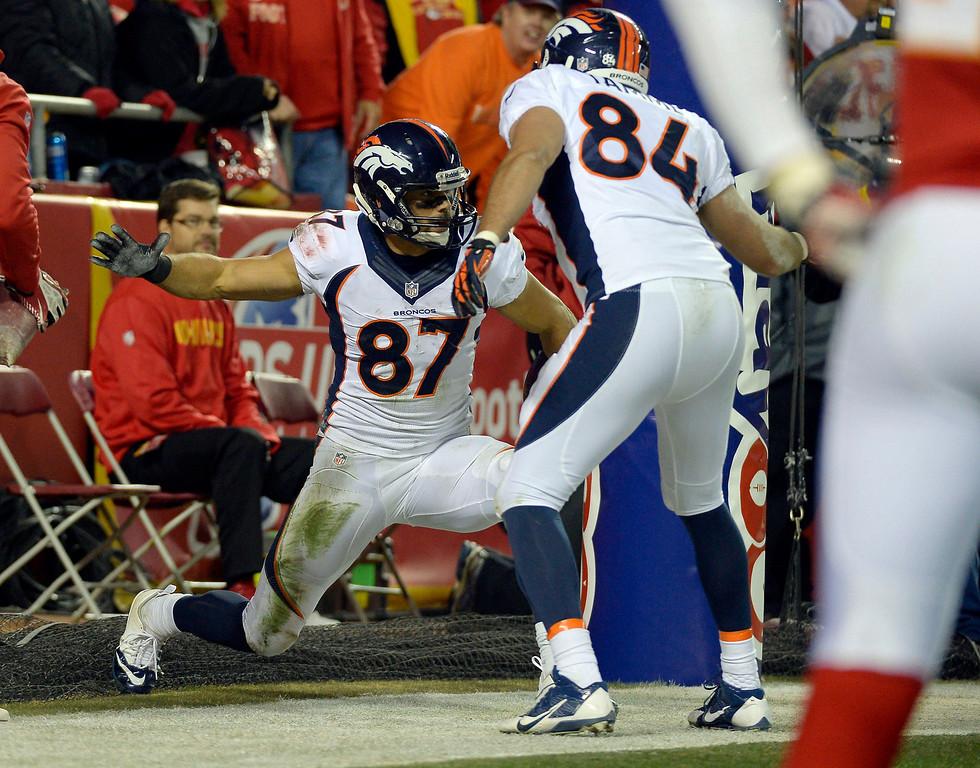 . Denver Broncos wide receiver Eric Decker (87) celebrates his touchdown with Denver Broncos tight end Jacob Tamme (84) during the third quarter against the Kansas City Chiefs December 1, 2013 at Arrowhead Stadium.  (Photo by John Leyba/The Denver Post)