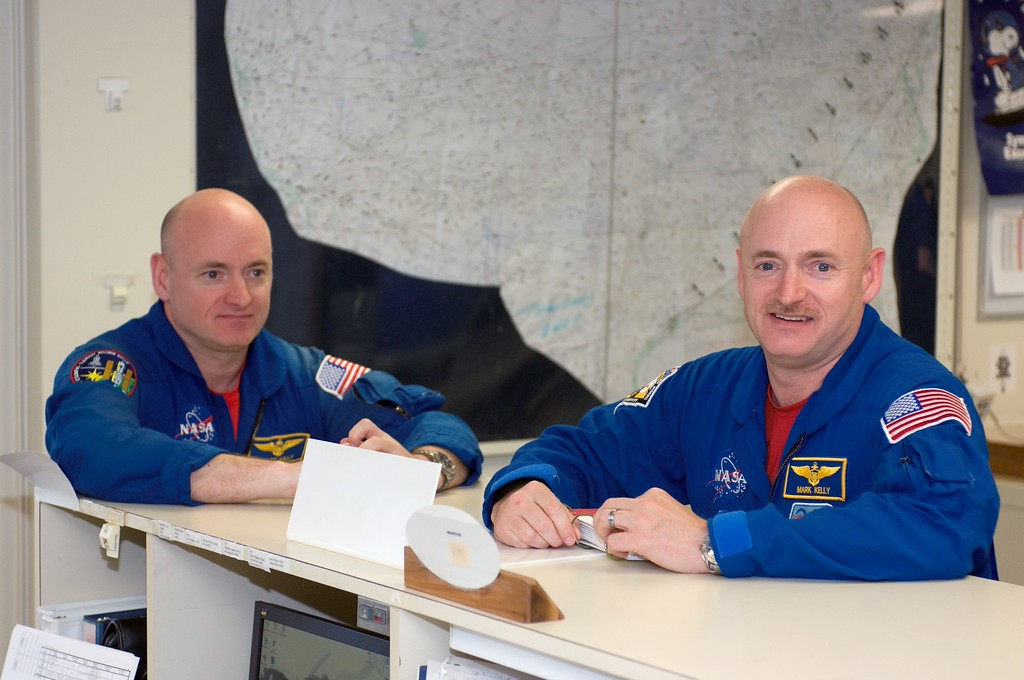 . This undated photo provided by NASA,  astronauts Mark Kelly, right, STS-124 commander, and Scott Kelly are pictured in the check-out facility at Ellington Field near NASA\'s Johnson Space Center in Houston.   NASA announced Friday, March 7, 2014,  that Mark Kelly and astronaut Scott Kelly will participate in 10 different investigations. Craig Kundrot, deputy chief scientist of NASA\'s Human Research Program, says in a news release that the brothers provide a unique opportunity to study two people with the same genetics who were in different environments. Officials say Scott Kelly spent a year in space while Mark Kelly was on Earth. NASA says it is hoping the studies can be the basis for future research initiatives.  (AP Photo/NASA)