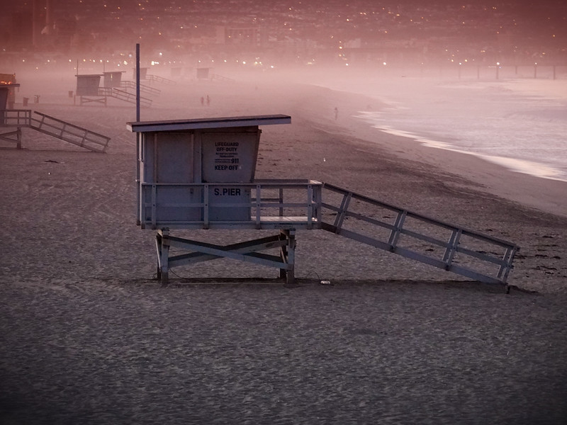 A lifeguard station before the sunrise, set against the lights of Hermosa Beach and the Palos Verdes Penisula