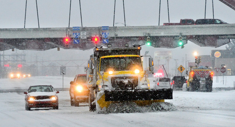 . A Indiana State Highway Garage snow plows moves work along Jonathan Moore Pike in Columbus, Ind. Wednesday Dec. 26, 2012. The blizzard warning issued the day before by National Weather Service came to fruition in the region as winds picked up and snow began falling in earnest before dawn. (AP Photo/The Republic, Joe Harpring)
