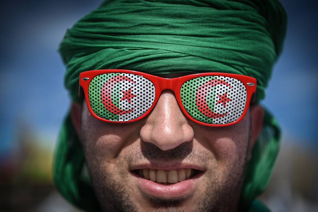 . An Algerian supporter is seen outside the Mineirao Stadium in Belo Horizonte, Brazil on June 17, 2014 before the match Belgium vs Algeria for the Group H of the FIFA World Cup Brazil 2014. GUSTAVO ANDRADE/AFP/Getty Images