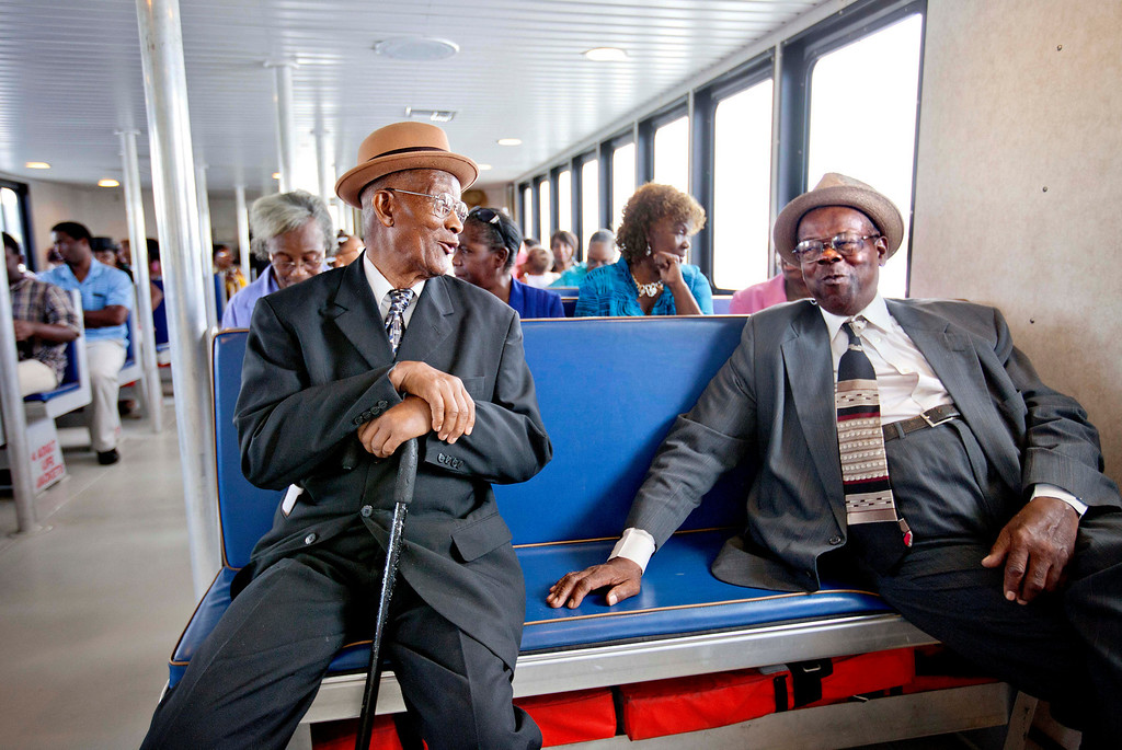 . Rev. Dr. Robert Brown, 89, left, and Eddie Wilson, 65, ride a ferry from the mainland to attend a church service for the 129th anniversary of St. Luke Baptist Church on Sapelo Island, Ga. on Sunday, June 9, 2013. (AP Photo/David Goldman)