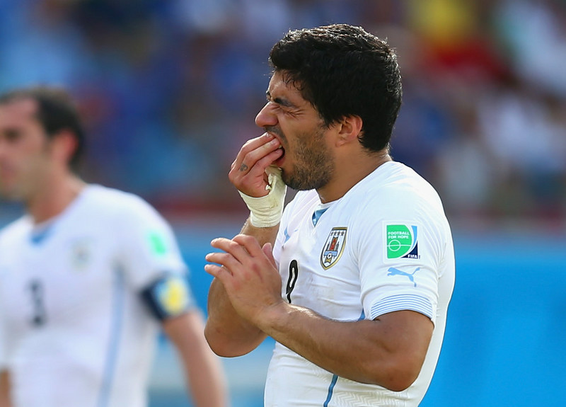 . Luis Suarez of Uruguay reacts during the 2014 FIFA World Cup Brazil Group D match between Italy and Uruguay at Estadio das Dunas on June 24, 2014 in Natal, Brazil.  (Photo by Clive Rose/Getty Images)