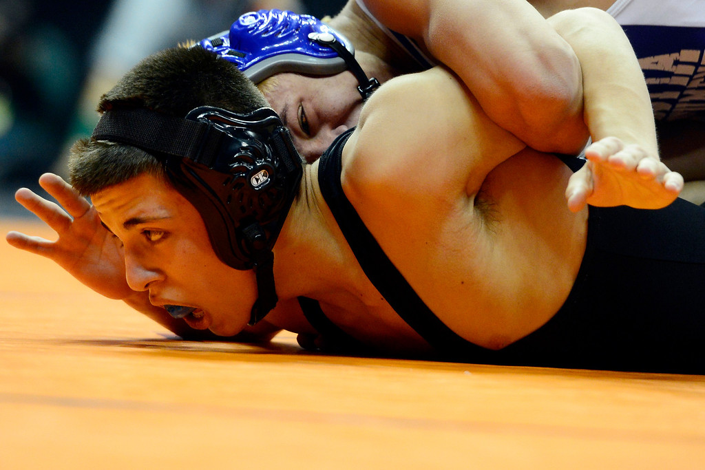 . DENVER, CO - FEBRUARY 21: Fruita 120-pounder Ian Konrad works a wing on top of Mountain Range\'s Zach Martinez during the Colorado State High School Wrestling Championships. The state finals will run through Saturday evening at the Pepsi Center. (Photo by AAron Ontiveroz/The Denver Post)