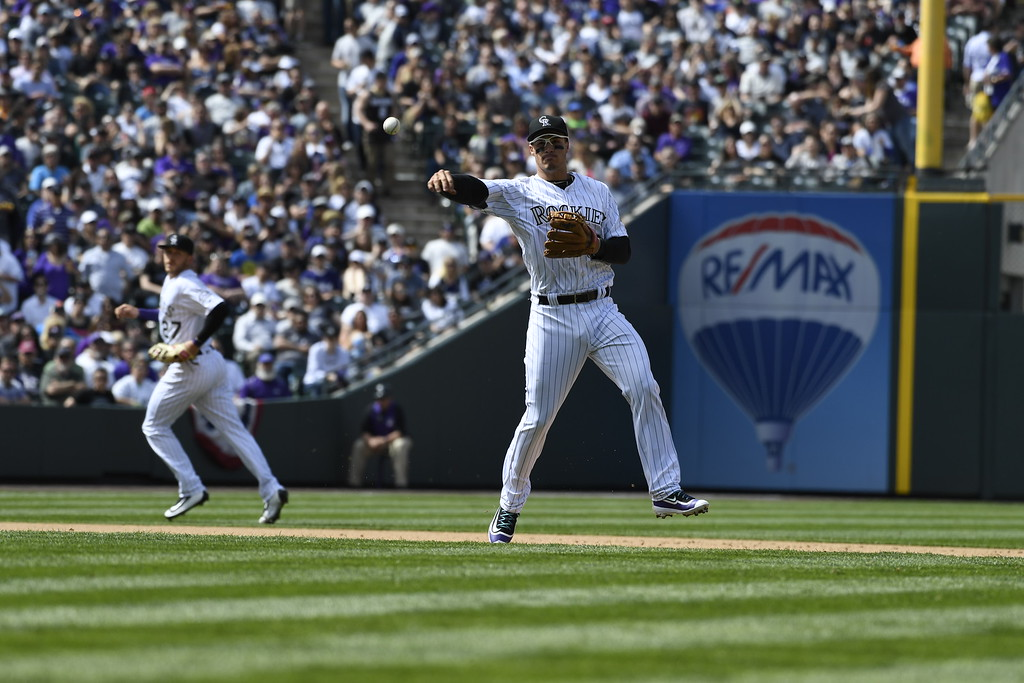 . Nolan Arenado (28) of the Colorado Rockies throws out Colin Rea (29) of the San Diego Padres to end the first half of the second inning. The Colorado Rockies played the San Diego Padres Friday, April 8, 2016 on opening day at Coors Field in Denver, Colorado. (Photo By Andy Cross/The Denver Post)
